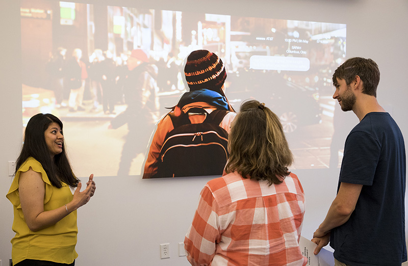 Image of student discussing work in a gallery space