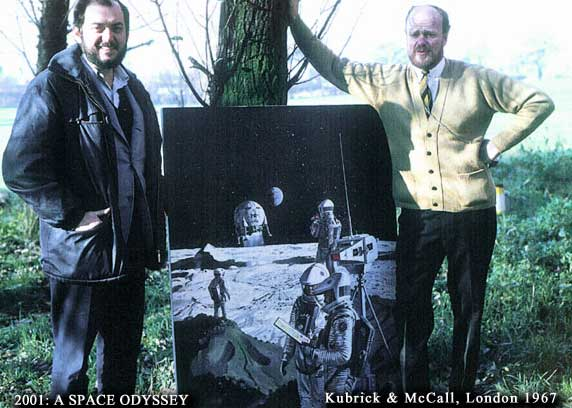 Kubrick and McCall standing on either side of movie poster, outdoors.