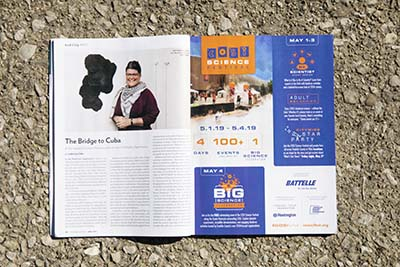 Magazine spread of article on Julie Abijanac and Cuba in Columbus