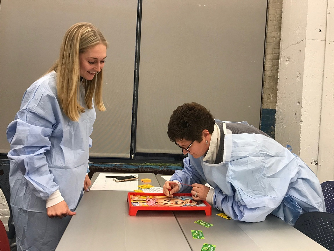 MDes students research better surgical gown design via the game Operation