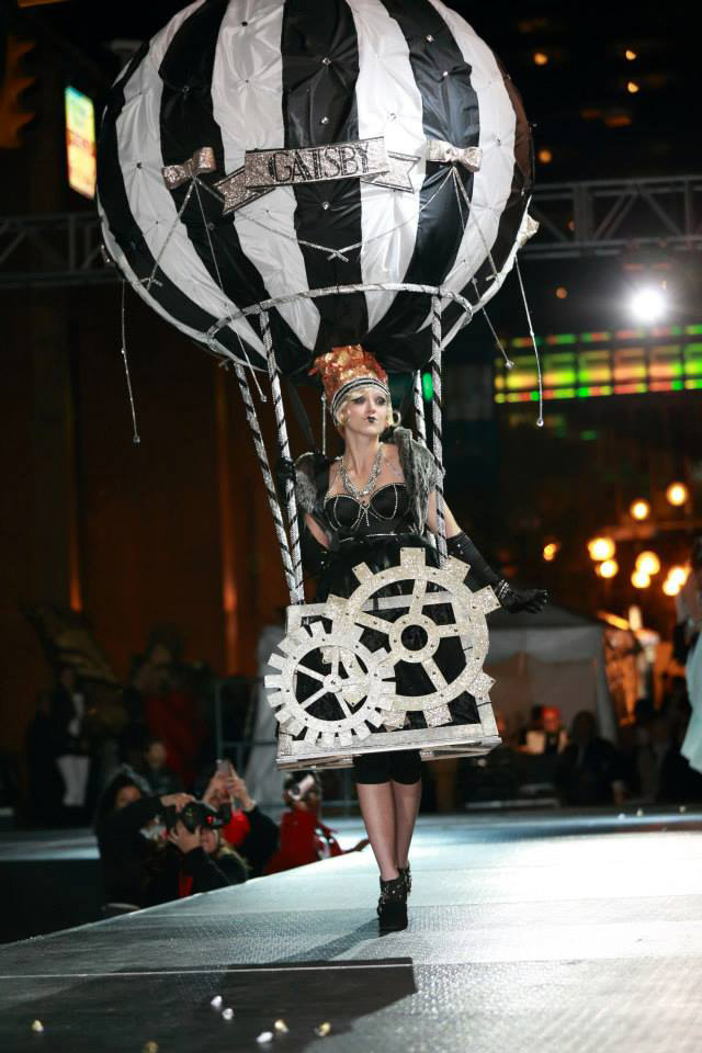 Fashion Design, Annie Weirauch's hot air balloon costume for HighBall Halloween, Model on runway dressed in black and white model of hot air balloon