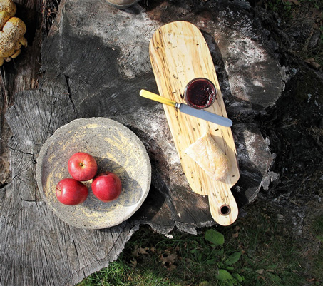 Interior Design, Wooden bread board on a wooden table with a plate of three apples