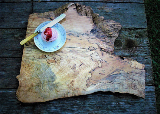Interior Design, Rustic wooden serving board on wooden table with pink cupcake on a plate