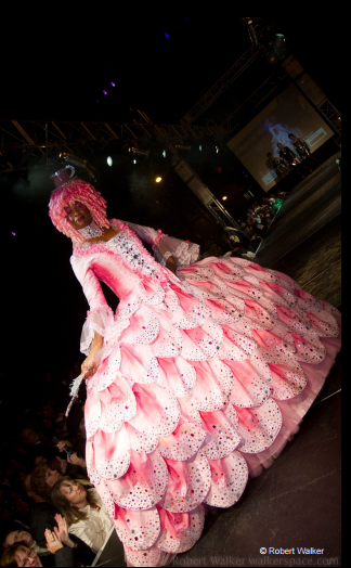 Fashion Design, Kevin Kerr's pink flower costume for HighBall Halloween, image of model in voluminous pink petal gown with pink wig