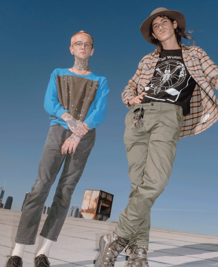 Fine Arts, Alix Ross and Elijah Funk pose for photo standing against backdrop of blue sky