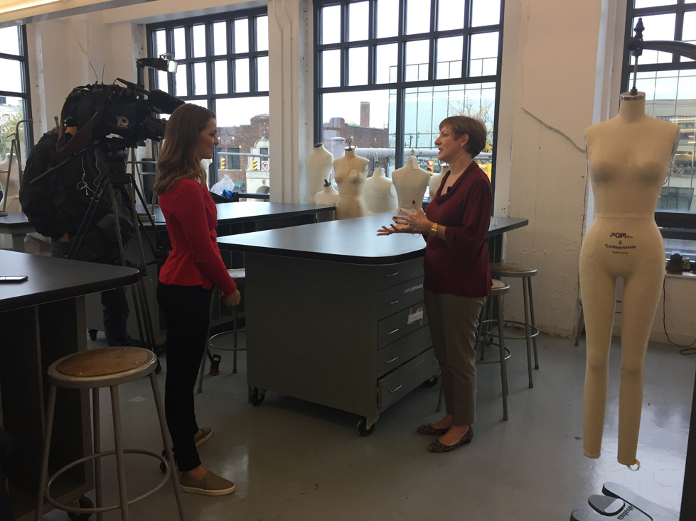Fashion Design, CCAD Fashion Design Assistant Professor Rebecca Robinson talks about vanity sizing with reporter and camera in classroom