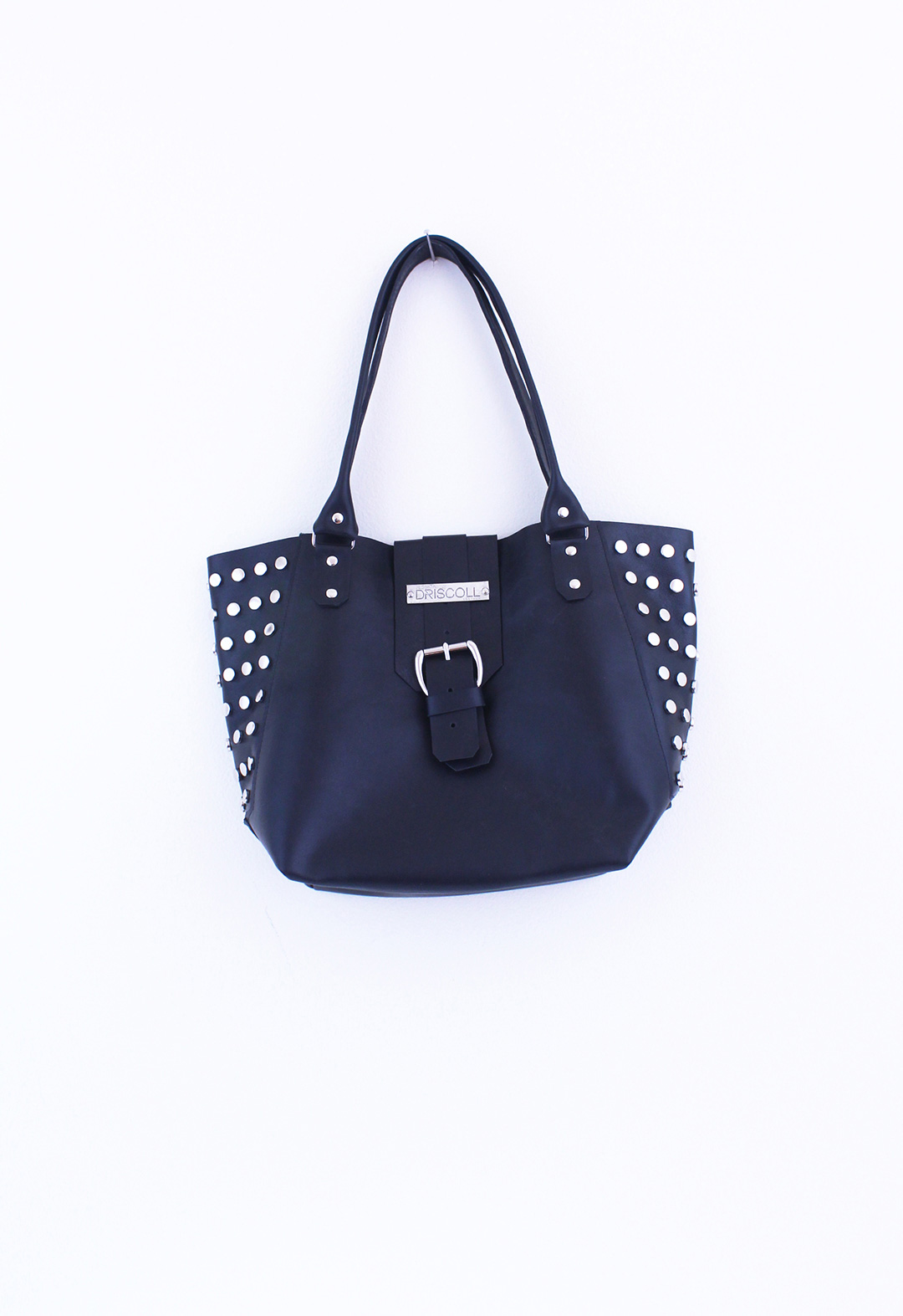 Fashion Design, Image of black handbag with silver hardware and studs on white background