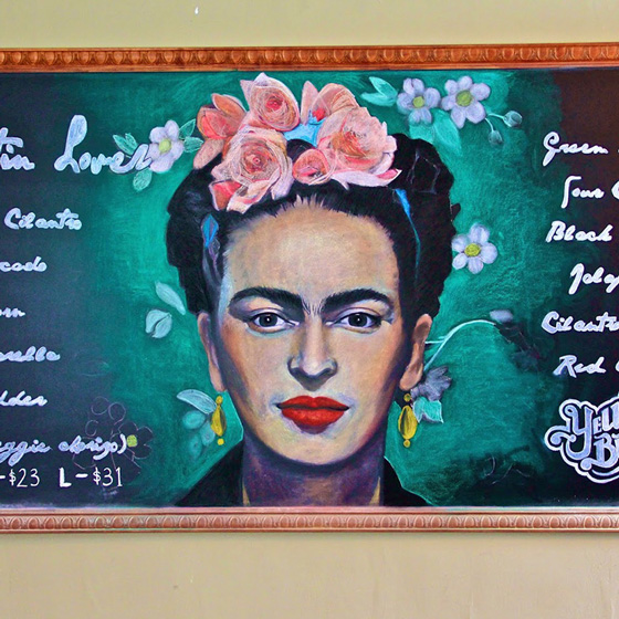 Fine Arts, Chalk Portrait of Frida Kahlo in pink flower crown surrounded by green glow for Yellow Brick Pizza