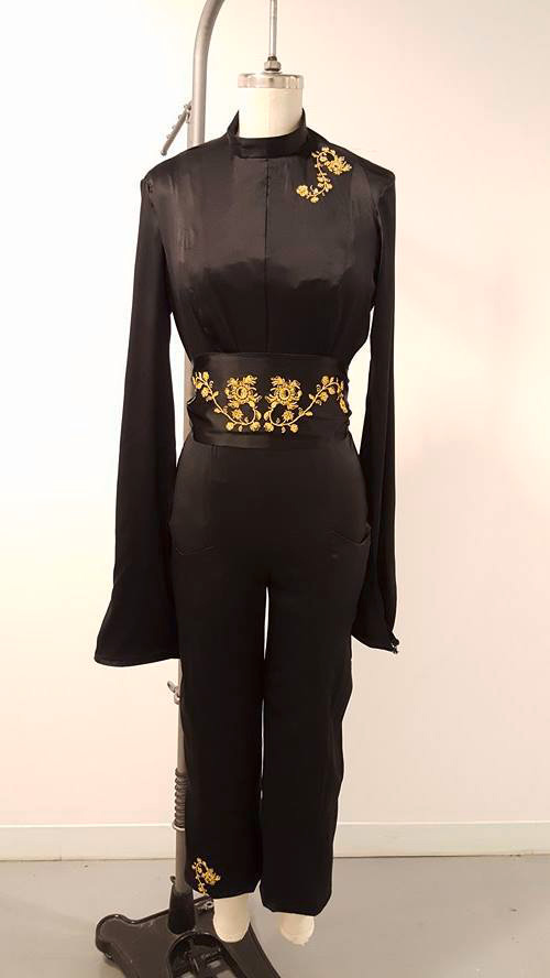Fashion Design, Black long sleeve jumpsuit on mannequin with gold accents and details