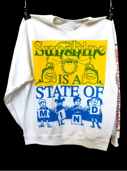 Fine Arts, Photo of white sweatshirt with yellow, green, and blue printed design