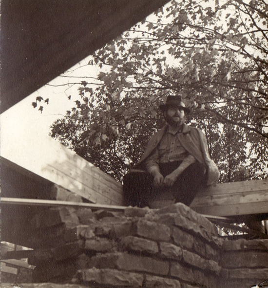 Renowned sculptor Tony Smith in front of a Usonian home he designed in Ohio