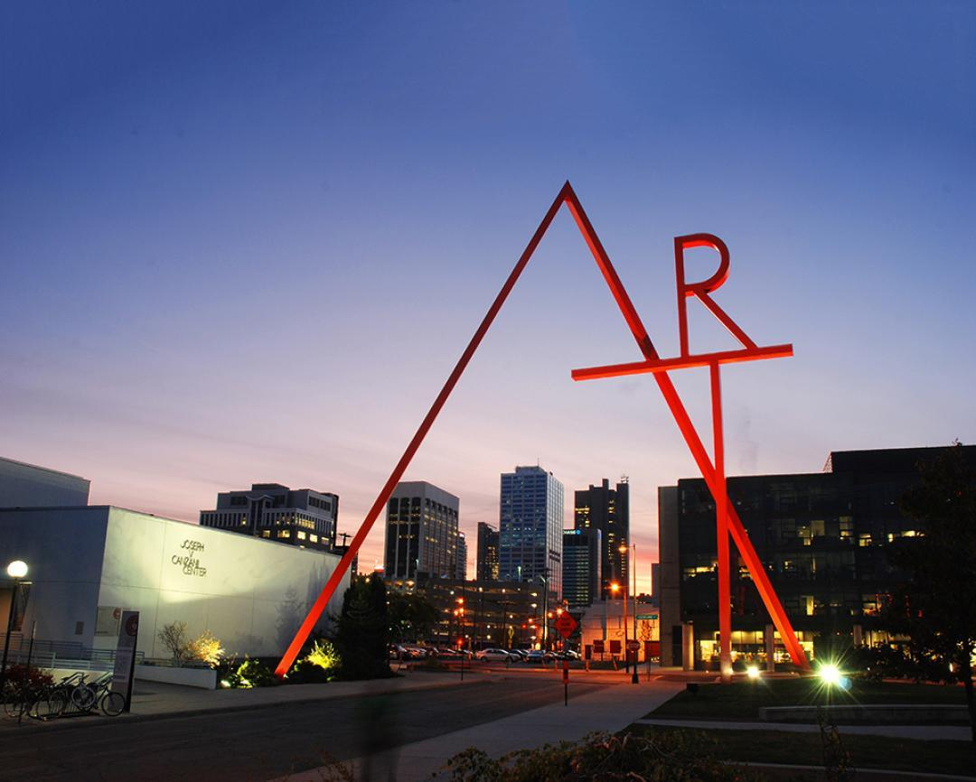 CCAD's iconic 100' tall ART sculpture backlit against the Columbus skyline