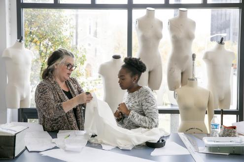 suzanne and student working with fabric