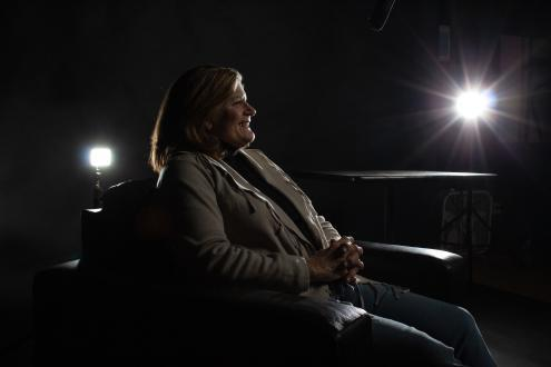 woman sitting in chair with lights