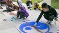 Photos of students painting with chalk